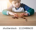 blurry little boy face counting ... | Shutterstock . vector #1113488633