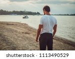 sad fit man standing on the... | Shutterstock . vector #1113490529