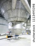 Small photo of Pocatello, Idaho, USA July7, 2017 A high tech stailnless steel hopper in a clean, modern food processing facility.