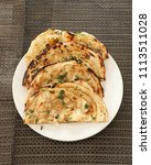 indian naan bread made with... | Shutterstock . vector #1113511028