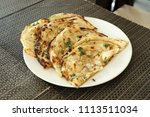 indian naan bread made with... | Shutterstock . vector #1113511034