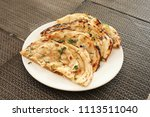 indian naan bread made with... | Shutterstock . vector #1113511040