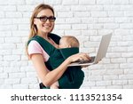 mom with laptop holding newborn ...   Shutterstock . vector #1113521354