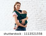 smiling mother with newborn... | Shutterstock . vector #1113521558