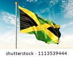 jamaica flag on the blue sky... | Shutterstock . vector #1113539444