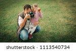 a man photographer with a...   Shutterstock . vector #1113540734