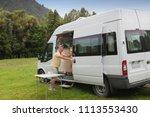 man with campervan on... | Shutterstock . vector #1113553430
