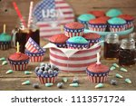 cupcakes red and blue velvet on ... | Shutterstock . vector #1113571724