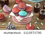 cupcakes red and blue velvet on ... | Shutterstock . vector #1113571730