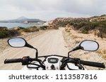 atv quad bike driving along the ... | Shutterstock . vector #1113587816