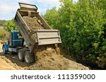 a 10 yard dump truck dumps its...