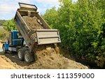 A 10 Yard Dump Truck Dumps Its...