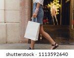 crop picture of girl walking... | Shutterstock . vector #1113592640