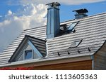 standing seam steel chimneys... | Shutterstock . vector #1113605363