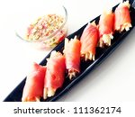 salmon wrapped apples salad | Shutterstock . vector #111362174
