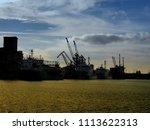 dockyard with heavy freight... | Shutterstock . vector #1113622313