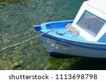 small fishing boats anchored in ... | Shutterstock . vector #1113698798