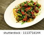 paneer chilli  made  with spicy ... | Shutterstock . vector #1113716144