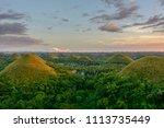 chocolate hills in the... | Shutterstock . vector #1113735449
