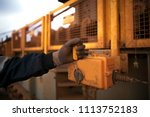 using yellow safety pull... | Shutterstock . vector #1113752183