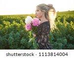 cute young blonde girl spends... | Shutterstock . vector #1113814004