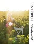 cute young blond girl sits on a ... | Shutterstock . vector #1113814730