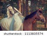 beautiful girl blond rider in... | Shutterstock . vector #1113835574