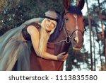 beautiful girl blond rider in... | Shutterstock . vector #1113835580