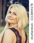 beautiful blonde woman in a... | Shutterstock . vector #1113844178