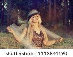 beautiful blonde woman in a... | Shutterstock . vector #1113844190