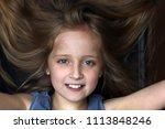little girl is smiling.   Shutterstock . vector #1113848246