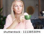 indoor shot of beautiful blonde ... | Shutterstock . vector #1113853094