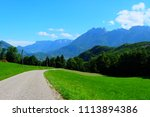 embraced by greenery mountains... | Shutterstock . vector #1113894386