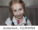 portrait of a cute little girl... | Shutterstock . vector #1113933968