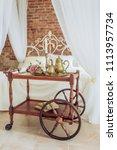 vintage elegant serving table... | Shutterstock . vector #1113957734