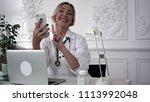 smiling female doctor making... | Shutterstock . vector #1113992048