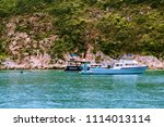 recreational boats anchoring... | Shutterstock . vector #1114013114
