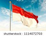 indonesia flag on the blue sky... | Shutterstock . vector #1114072703
