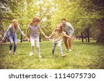 young happy family running ... | Shutterstock . vector #1114075730