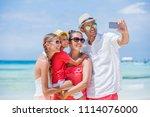 family of four making selfie... | Shutterstock . vector #1114076000