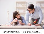 two medical students studying... | Shutterstock . vector #1114148258