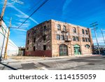 Small photo of Los Angeles, California / USA - March 4, 2018: The Starkman Building located in the Arts District of Los Angeles. It was constructed in 1908 and was a factory for the Nate Starkman and Son company.