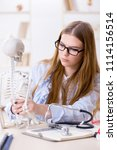 student sitting in classroom... | Shutterstock . vector #1114156514