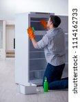 man cleaning fridge in hygiene...   Shutterstock . vector #1114162733
