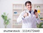 doctor with bag of blood plasma ...   Shutterstock . vector #1114172660