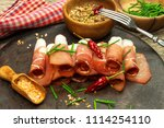 thinly sliced german black... | Shutterstock . vector #1114254110
