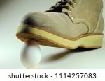 white egg under the sole of a...   Shutterstock . vector #1114257083