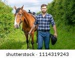 good looking  hunky cowboy... | Shutterstock . vector #1114319243