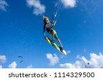 professional kiter makes the... | Shutterstock . vector #1114329500