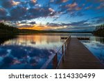 Boat Dock. Sunset Over The Lake....